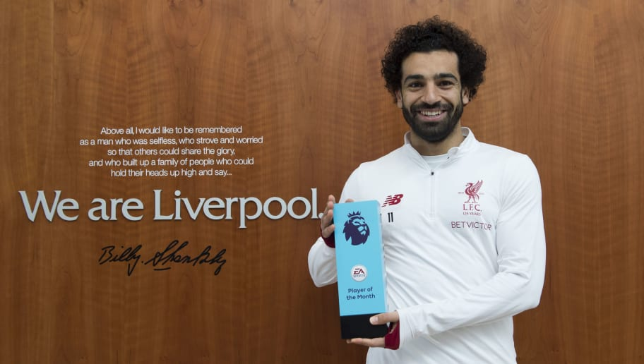 LIVERPOOL, ENGLAND - MARCH 08: Mohamed Salah is Awarded with the EA SPORTS Player of the Month for February at Melwood Training Ground on March 8, 2018 in Liverpool, England. (Photo by Nathan Stirk/Getty Images for Premier League)