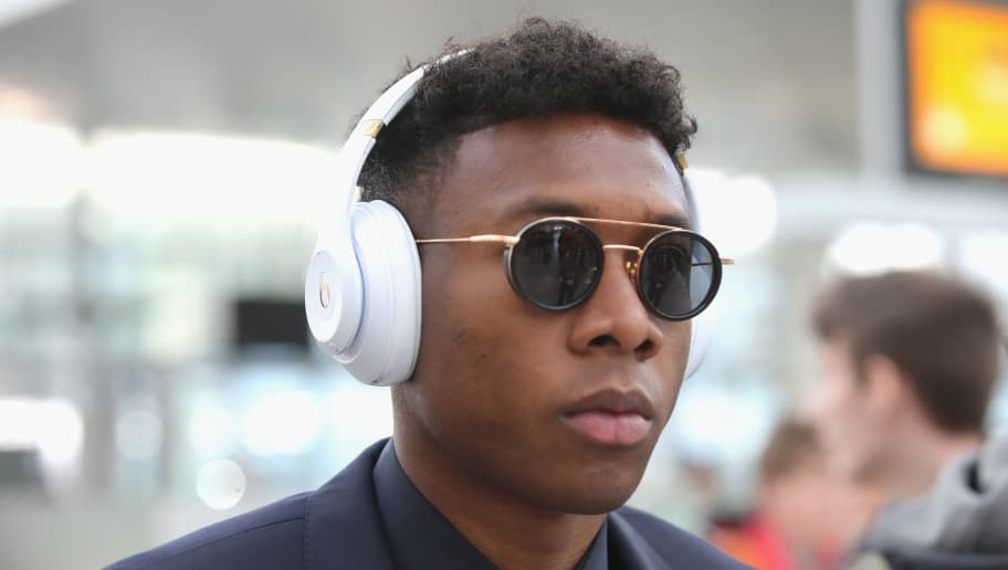MUNICH, GERMANY - MARCH 13: David Alaba  of FC Bayern Muenchen arrives at Munich international airport 'Franz Josef Strauss' prior their team flight for the UEFA Champions League Round of 16 Second Leg match against Besiktas Istanbul on March 13, 2018 in Munich, Germany.  (Photo by Alexander Hassenstein/Bongarts/Getty Images)