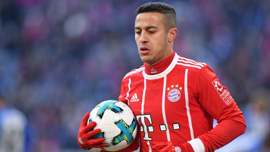 MUNICH, GERMANY - FEBRUARY 24: Thiago Alcantara of Bayern Muenchen looks down during the Bundesliga match between FC Bayern Muenchen and Hertha BSC at Allianz Arena on February 24, 2018 in Munich, Germany. (Photo by Sebastian Widmann/Bongarts/Getty Images)