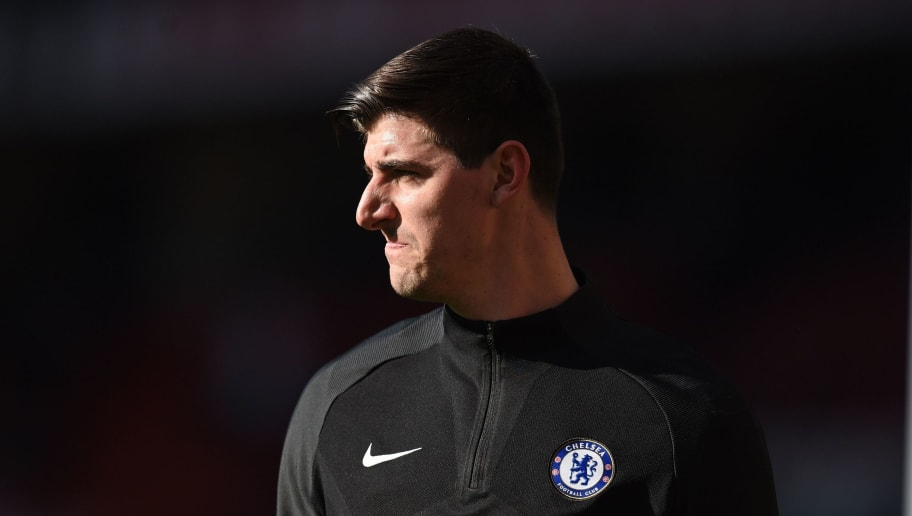 Chelsea's Belgian goalkeeper Thibaut Courtois warms up ahead of the English Premier League football match between Manchester United and Chelsea at Old Trafford in Manchester, north west England, on February 25, 2018. / AFP PHOTO / Oli SCARFF / RESTRICTED TO EDITORIAL USE. No use with unauthorized audio, video, data, fixture lists, club/league logos or 'live' services. Online in-match use limited to 75 images, no video emulation. No use in betting, games or single club/league/player publications.  /         (Photo credit should read OLI SCARFF/AFP/Getty Images)