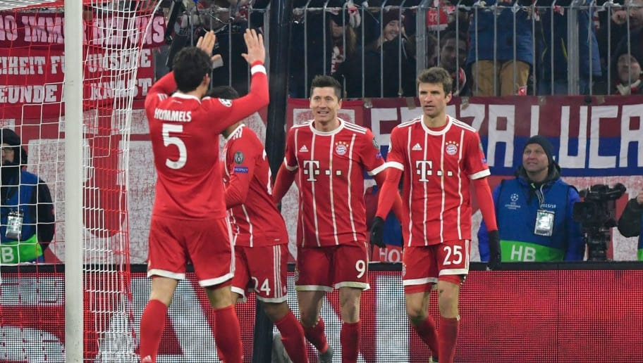 Bayern Munich's Polish forward Robert Lewandowski celebrates with teammates after he scored during the UEFA Champions League round of sixteen first leg football match Bayern Munich vs Besiktas Istanbul on February 20, 2018 in Munich, southern Germany. / AFP PHOTO / John MACDOUGALL        (Photo credit should read JOHN MACDOUGALL/AFP/Getty Images)