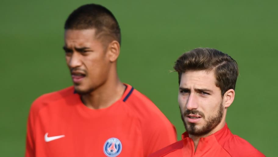 Paris Saint-Germain's German goalkeeper Kevin Trapp (R) and Paris Saint-Germain's French goalkeeper Alphonse Areola look on as they attend a training session at Saint-Germain-en-Laye, western Paris on October 17, 2017, on the eve of the UEFA Champions League football match against Anderlecht. / AFP PHOTO / FRANCK FIFE        (Photo credit should read FRANCK FIFE/AFP/Getty Images)