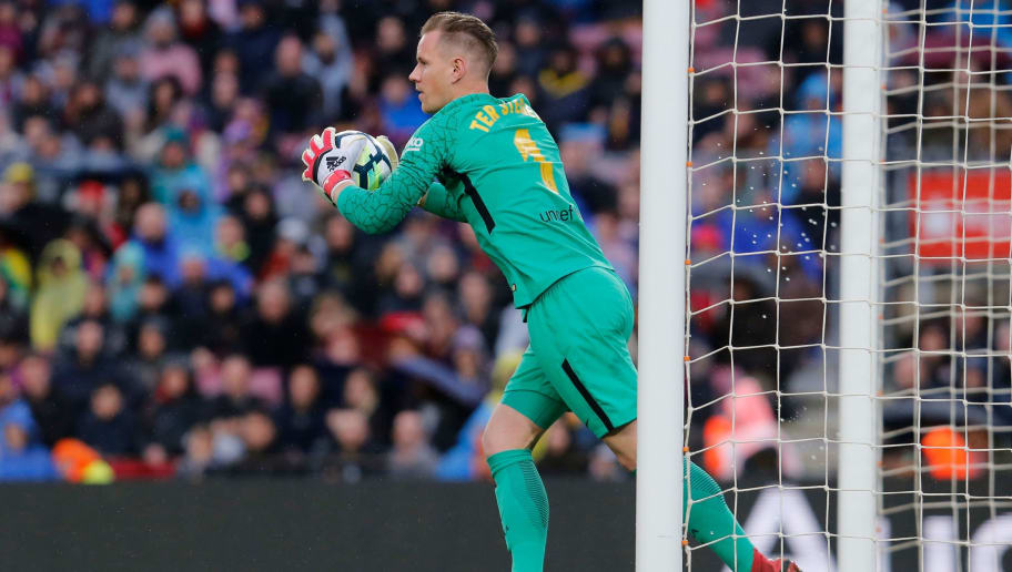 Barcelona's German goalkeeper Marc-Andre Ter Stegen grabs the ball during the Spanish league football match FC Barcelona against Club Atletico de Madrid at the Camp Nou stadium in Barcelona on March 04, 2018. / AFP PHOTO / Pau Barrena        (Photo credit should read PAU BARRENA/AFP/Getty Images)