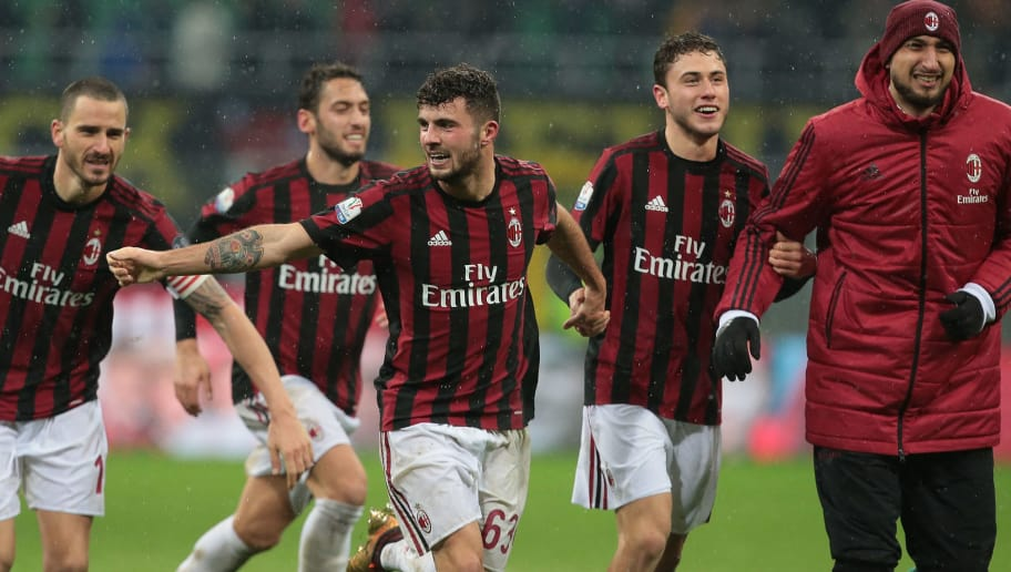 MILAN, ITALY - DECEMBER 27:  Patrick Cutrone of AC Milan (C) celebrates the victory  with his teammates Leonardo Bonucci (L) and Gianlugi Donnarumma (R) at the end of the TIM Cup match between AC Milan and FC Internazionale at Stadio Giuseppe Meazza on December 27, 2017 in Milan, Italy.  (Photo by Emilio Andreoli/Getty Images)