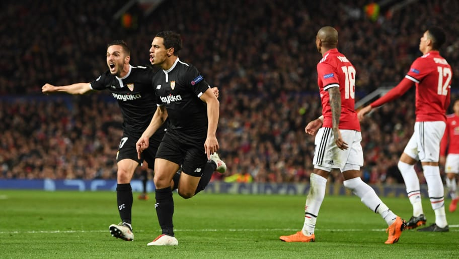 MANCHESTER, ENGLAND - MARCH 13:  Wissam Ben Yedder of Sevilla (front) celebrates as he scores their first goal during the UEFA Champions League Round of 16 Second Leg match between Manchester United and Sevilla FC at Old Trafford on March 13, 2018 in Manchester, United Kingdom.  (Photo by Michael Regan/Getty Images)