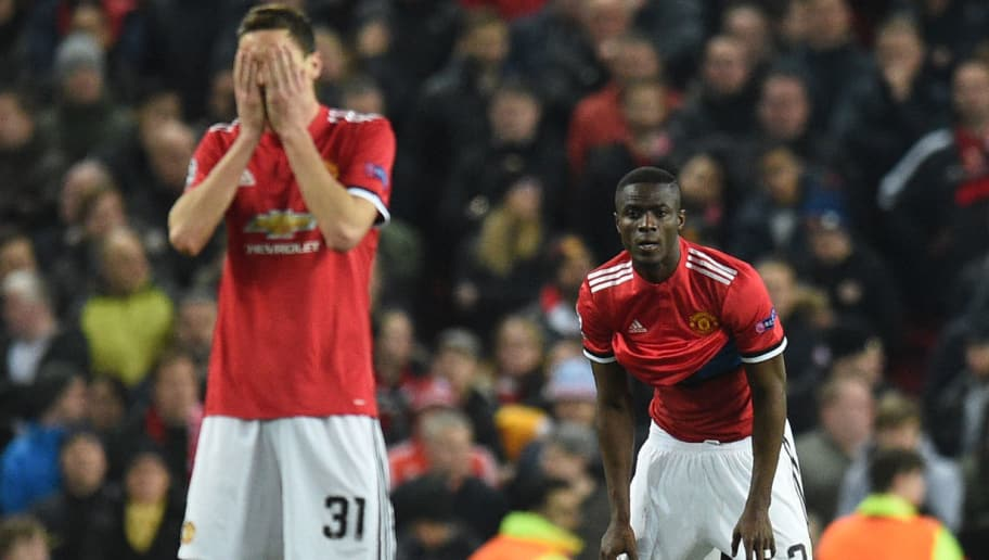 Manchester United's Serbian midfielder Nemanja Matic (L) and Manchester United's Ivorian defender Eric Bailly react after Sevilla scored their first goal during a last 16 second leg UEFA Champions League football match between Manchester United and Sevilla at Old Trafford in Manchester, northwest England on March 13, 2018. / AFP PHOTO / Oli SCARFF        (Photo credit should read OLI SCARFF/AFP/Getty Images)