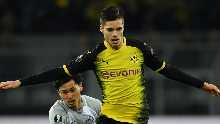 DORTMUND, GERMANY - MARCH 08:  Julian Weigl of Dortmund is challenged by Takumi Minamino of Salzburg during UEFA Europa League Round of 16 match between Borussia Dortmund and FC Red Bull Salzburg at the Signal Iduna Park on March 8, 2018 in Dortmund, Germany.  (Photo by Stuart Franklin/Bongarts/Getty Images)