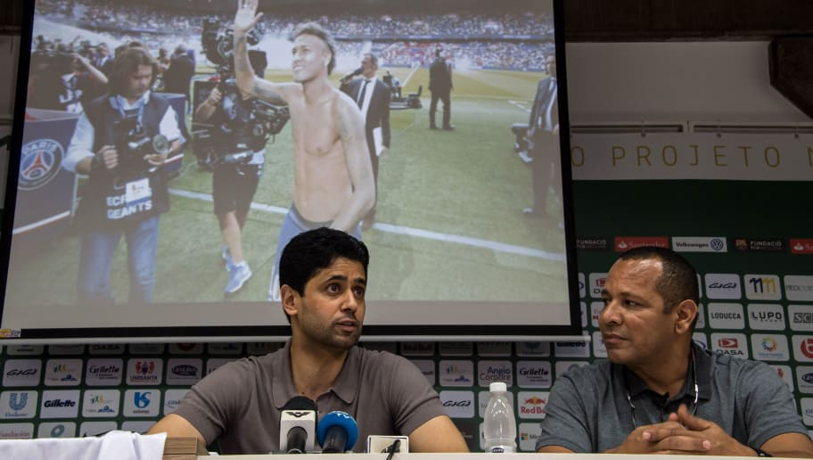 French football team Paris Saint-Germain's (PSG) Qatari president Nasser Al-Khelaifi (L) and Neymar Santos, father of Brazilian superstar and PSG's footballer Neymar Junior, deliver a press conference at Neymar Junior Institute project in Praia Grande, Sao Paulo state, Brazil on March 13, 2018.  Nasser Al-Khelaifi arrived in Brazil to visit the world's most expensive player, Neymar, who broke a bone in his right foot on February 25 and faces weeks of recuperation following surgery. The visit also takes place amid rumors swirling about the striker's intention to quit PSG. / AFP PHOTO / NELSON ALMEIDA        (Photo credit should read NELSON ALMEIDA/AFP/Getty Images)