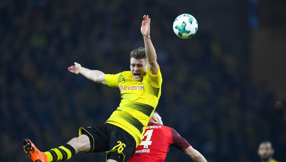 Dortmund's Polish defender Lukasz Piszczek (L) and Frankfurt's Croatian forward Ante Rebic vie for the ball during the German first division Bundesliga football match Borussia Dortmund vs Eintracht Frankfurt, in Dortmund, western Germany, on March 11, 2018. / AFP PHOTO / Patrik STOLLARZ / RESTRICTIONS: DURING MATCH TIME: DFL RULES TO LIMIT THE ONLINE USAGE TO 15 PICTURES PER MATCH AND FORBID IMAGE SEQUENCES TO SIMULATE VIDEO. == RESTRICTED TO EDITORIAL USE == FOR FURTHER QUERIES PLEASE CONTACT DFL DIRECTLY AT + 49 69 650050         (Photo credit should read PATRIK STOLLARZ/AFP/Getty Images)