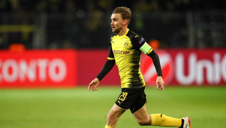 DORTMUND, GERMANY - MARCH 08: Marcel Schmelzer #29 of Borussia Dortmund controls the ball during UEFA Europa League Round of 16 match between Borussia Dortmund and FC Red Bull Salzburg at the Signal Iduna Park on March 8, 2018 in Dortmund, Germany. (Photo by Maja Hitij/Bongarts/Getty Images)