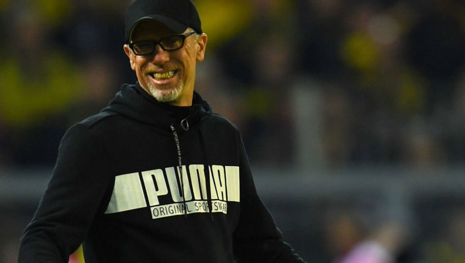 Dortmund's German headcoach Peter Stoeger reacts during the German first division Bundesliga football match Borussia Dortmund vs Eintracht Frankfurt, in Dortmund, western Germany, on March 11, 2018. / AFP PHOTO / Patrik STOLLARZ / RESTRICTIONS: DURING MATCH TIME: DFL RULES TO LIMIT THE ONLINE USAGE TO 15 PICTURES PER MATCH AND FORBID IMAGE SEQUENCES TO SIMULATE VIDEO. == RESTRICTED TO EDITORIAL USE == FOR FURTHER QUERIES PLEASE CONTACT DFL DIRECTLY AT + 49 69 650050         (Photo credit should read PATRIK STOLLARZ/AFP/Getty Images)