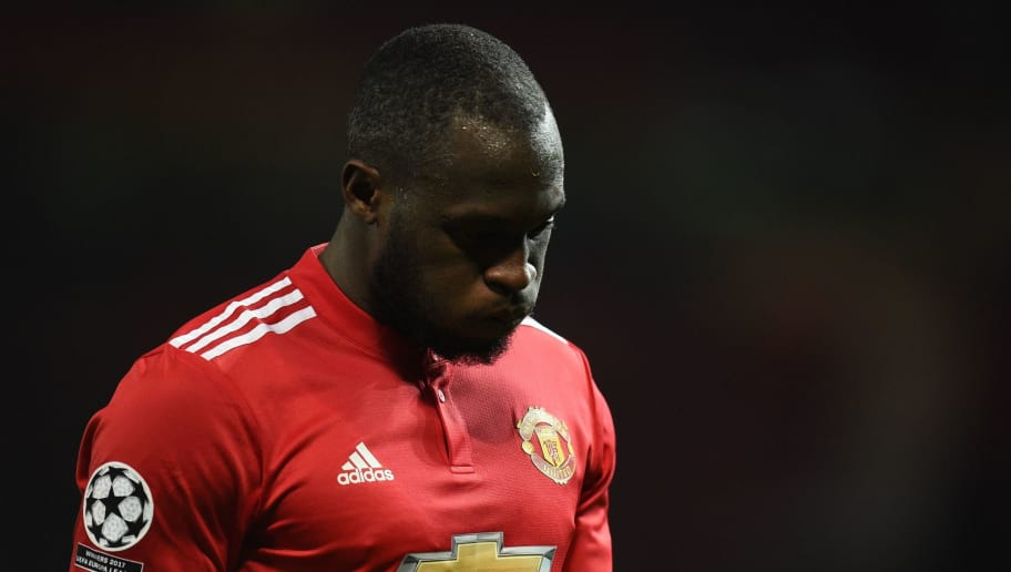 Manchester United's Belgian striker Romelu Lukaku reacts after losing a last 16 second leg UEFA Champions League football match between Manchester United and Sevilla at Old Trafford in Manchester, northwest England on March 13, 2018. / AFP PHOTO / Oli SCARFF        (Photo credit should read OLI SCARFF/AFP/Getty Images)