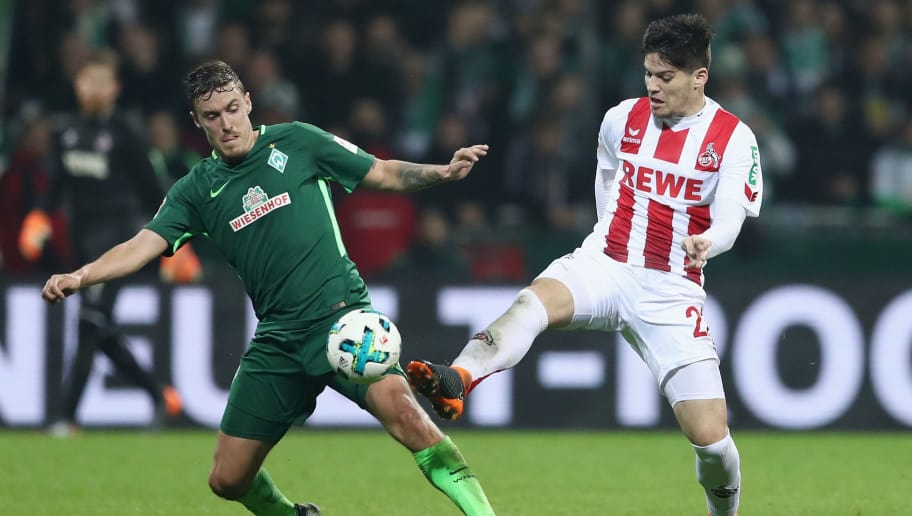 BREMEN, GERMANY - MARCH 12: Max Kruse (L) of Bremen is challenged by Jorge Mere of Koeln during the Bundesliga match between SV Werder Bremen and 1. FC Koeln at Weserstadion on March 12, 2018 in Bremen, Germany.  (Photo by Lars Baron/Bongarts/Getty Images)