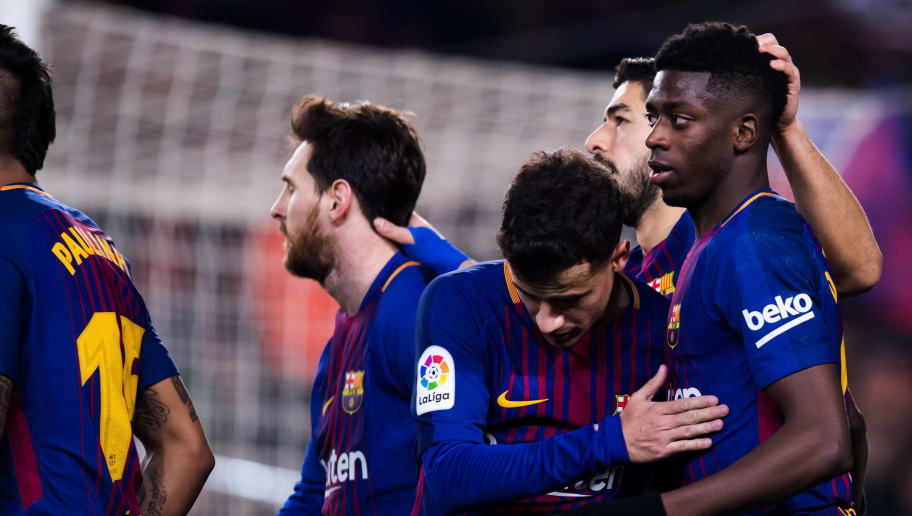 BARCELONA, SPAIN - FEBRUARY 24:  Ousmane Dembele of FC Barcelona is congratulated after assisting his teammate Luis Suarez to score their team's sixth goal during the La Liga match between Barcelona and Girona at Camp Nou on February 24, 2018 in Barcelona, Spain.  (Photo by Alex Caparros/Getty Images)