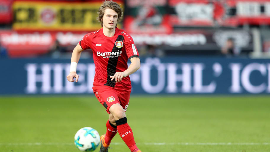 LEVERKUSEN, GERMANY - FEBRUARY 25: Tin Jedvaj of Leverkusen runs with the ball during the Bundesliga match between Bayer 04 Leverkusen and FC Schalke 04 at BayArena on February 25, 2018 in Leverkusen, Germany. (Photo by Christof Koepsel/Bongarts/Getty Images)