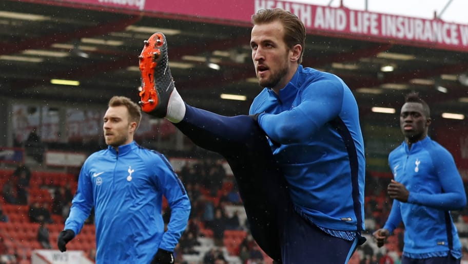 Tottenham Hotspur's English striker Harry Kane (C) warms up ahead of the English Premier League football match between Bournemouth and Tottenham Hotspur at the Vitality Stadium in Bournemouth, southern England on March 11, 2018. / AFP PHOTO / Adrian DENNIS / RESTRICTED TO EDITORIAL USE. No use with unauthorized audio, video, data, fixture lists, club/league logos or 'live' services. Online in-match use limited to 75 images, no video emulation. No use in betting, games or single club/league/player publications.  /         (Photo credit should read ADRIAN DENNIS/AFP/Getty Images)