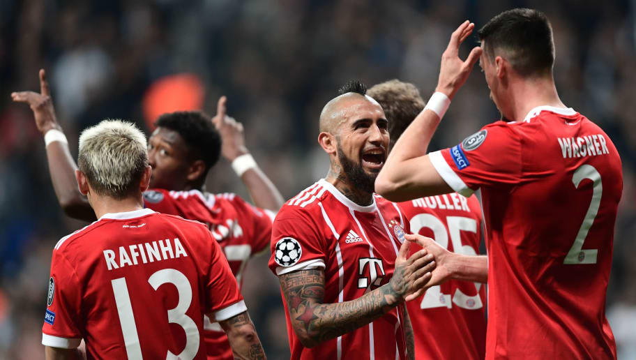 Bayern Munich's forward Sandro Wagner (R) celebrates with teammates including Chilean midfielder Arturo Vidal (C) after scoring during the second leg of the last 16 UEFA Champions League football match between Besiktas and Bayern Munich at Besiktas Park in Istanbul on March 14, 2018.  / AFP PHOTO / OZAN KOSE        (Photo credit should read OZAN KOSE/AFP/Getty Images)
