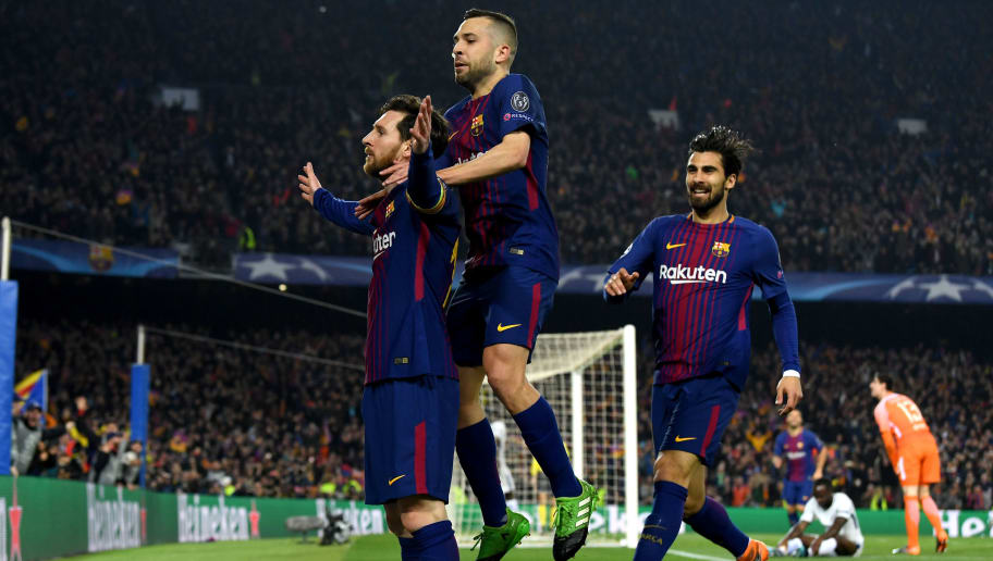 BARCELONA, SPAIN - MARCH 14:  Lionel Messi of Barcelona celebrates with Jordi Alba and Andre Gomes as he scores their third goal during the UEFA Champions League Round of 16 Second Leg match FC Barcelona and Chelsea FC at Camp Nou on March 14, 2018 in Barcelona, Spain.  (Photo by David Ramos/Getty Images)