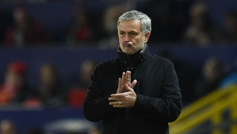 Manchester United's Portuguese manager Jose Mourinho applauds during a last 16 second leg UEFA Champions League football match between Manchester United and Sevilla at Old Trafford in Manchester, northwest England on March 13, 2018. / AFP PHOTO / Oli SCARFF        (Photo credit should read OLI SCARFF/AFP/Getty Images)