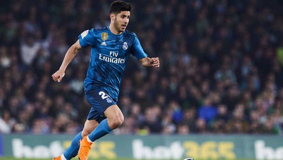 SEVILLE, SPAIN - FEBRUARY 18:  Marco Asensio of Real Madrid controls the ball during the La Liga match between Real Betis and Real Madrid at Benito Villamrin stadium on February 18, 2018 in Seville, Spain.  (Photo by Aitor Alcalde/Getty Images)