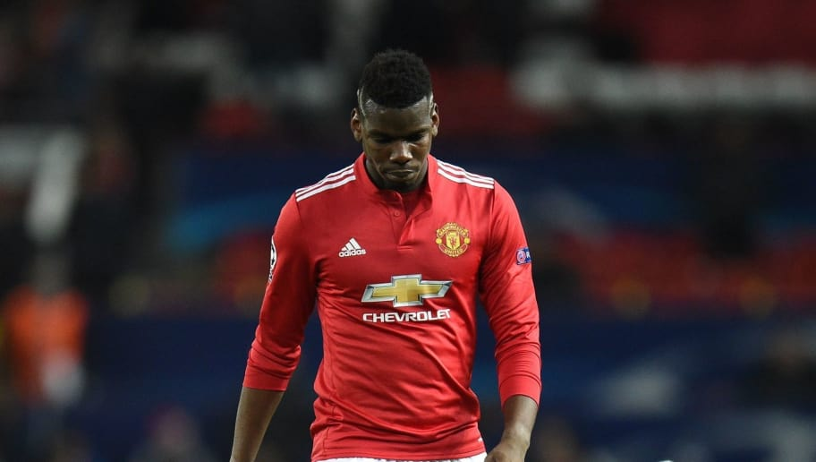 TOPSHOT - Manchester United's French midfielder Paul Pogba leaves the pitch after losing a last 16 second leg UEFA Champions League football match between Manchester United and Sevilla at Old Trafford in Manchester, northwest England on March 13, 2018. / AFP PHOTO / Oli SCARFF        (Photo credit should read OLI SCARFF/AFP/Getty Images)