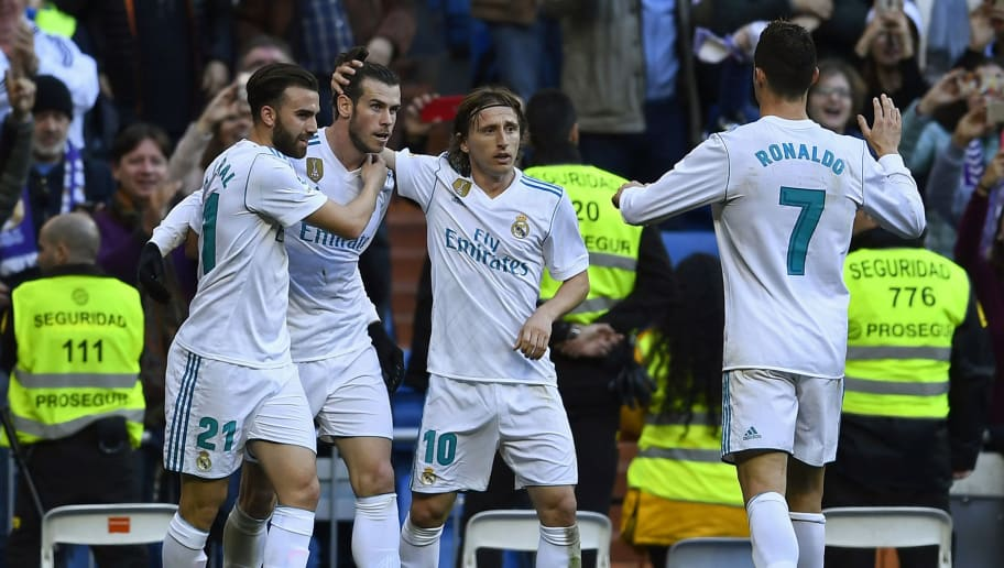 Real Madrid's Welsh forward Gareth Bale (2L) celebrates with Real Madrid's Spanish forward Borja Mayoral (L), Real Madrid's Croatian midfielder Luka Modric (2R) and Real Madrid's Portuguese forward Cristiano Ronaldo after scoring during the Spanish league football match between Real Madrid CF and RC Deportivo de la Coruna at the Santiago Bernabeu stadium in Madrid on January 21, 2018. / AFP PHOTO / OSCAR DEL POZO        (Photo credit should read OSCAR DEL POZO/AFP/Getty Images)