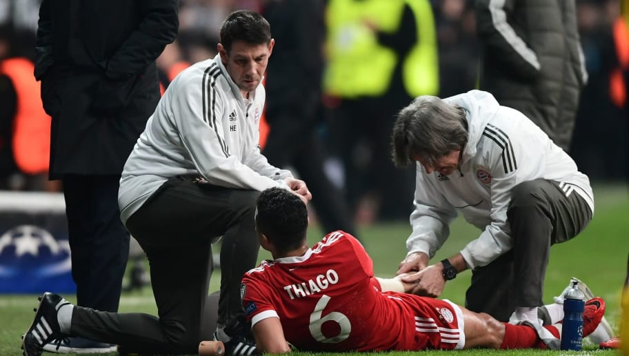 Bayern Munich's Spanish midfielder Thiago Alcantara (C) is treated by coaching staff during the second leg of the last 16 UEFA Champions League football match between Besiktas and Bayern Munich at Besiktas Park in Istanbul on March 14, 2018.  / AFP PHOTO / OZAN KOSE        (Photo credit should read OZAN KOSE/AFP/Getty Images)