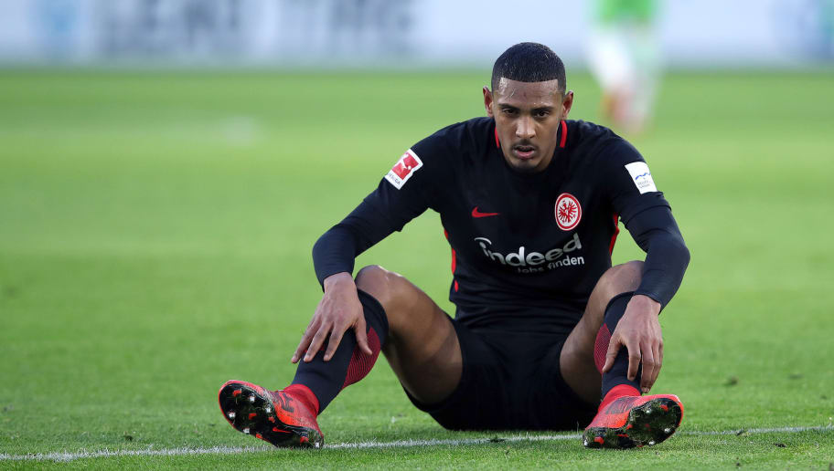 WOLFSBURG, GERMANY - JANUARY 20: Sebastian Haller of Frankfurt sits on the pitch during the Bundesliga match between VfL Wolfsburg and Eintracht Frankfurt at Volkswagen Arena on January 20, 2018 in Wolfsburg, Germany. (Photo by Ronny Hartmann/Bongarts/Getty Images)