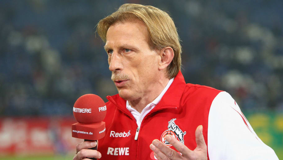 GELSENKIRCHEN, GERMANY - MARCH 06:  Head coach Christoph Daum of Koeln talks to Premiere television channel before the Bundesliga match between FC Schalke 04 and 1. FC Koeln at the Veltins-Arena on March 6, 2009 in Gelsenkirchen, Germany.  (Photo by Christof Koepsel/Bongarts/Getty Images)