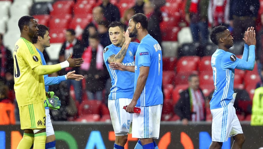 Olympique de Marseille players celebrate at the end of the UEFA Europa League round of sixteen second leg  football match between Athletic Club Bilbao and Olympique de Marseille at the San Mames stadium in Bilbao on March 15, 2018. / AFP PHOTO / ANDER GILLENEA        (Photo credit should read ANDER GILLENEA/AFP/Getty Images)