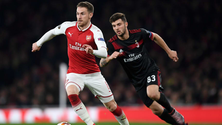 LONDON, ENGLAND - MARCH 15:  Aaron Ramsey of Arsenal breaks from Patrick Cutrone of AC Milan during the UEFA Europa League Round of 16 Second Leg match between Arsenal and AC Milan at Emirates Stadium on March 15, 2018 in London, England.  (Photo by Shaun Botterill/Getty Images)