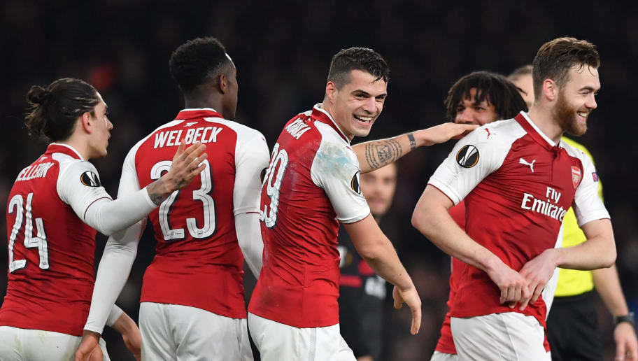 Arsenal's Swiss midfielder Granit Xhaka (C) celebrates with teammates scoring the team's second goal during the UEFA Europa League round of 16 second-leg football match  between Arsenal and AC Milan at the Emirates Stadium in London on March 15, 2018.  / AFP PHOTO / Ben STANSALL        (Photo credit should read BEN STANSALL/AFP/Getty Images)
