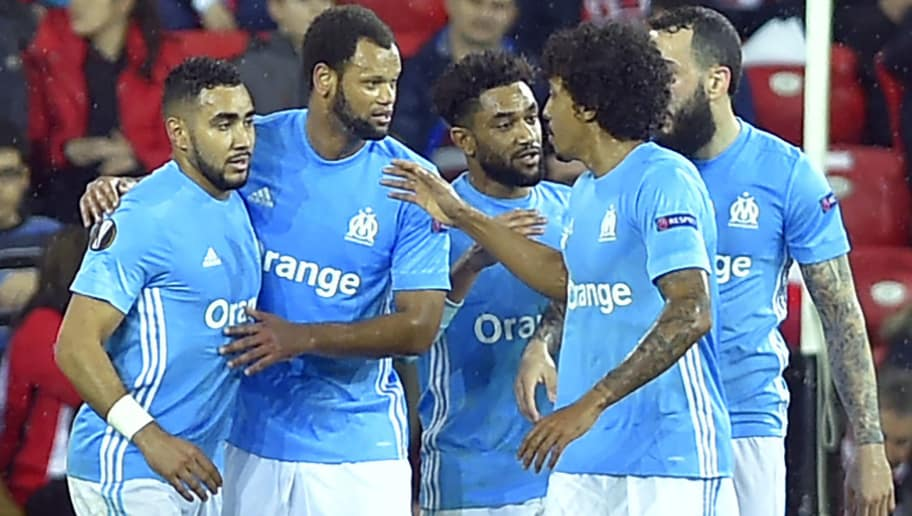 Olympique de Marseille's French midfielder Dimitri Payet (L) celebrates a goal during the UEFA Europa League round of sixteen second leg  football match between Athletic Club Bilbao and Olympique de Marseille at the San Mames stadium in Bilbao on March 15, 2018. / AFP PHOTO / ANDER GILLENEA        (Photo credit should read ANDER GILLENEA/AFP/Getty Images)