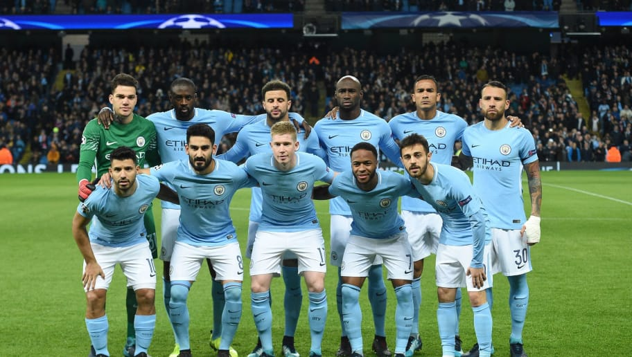 The Manchester City starting XI; (L-R top row) Manchester City's Brazilian goalkeeper Ederson, Manchester City's Ivorian midfielder Yaya Toure, Manchester City's English defender Kyle Walker, Manchester City's French defender Eliaquim Mangala, Manchester City's Brazilian defender Danilo, Manchester City's Argentinian defender Nicolas Otamendi, (L-R bottom row) Manchester City's Argentinian striker Sergio Aguero, Manchester City's German midfielder Ilkay Gundogan, Manchester City's Belgian midfielder Kevin De Bruyne, Manchester City's English midfielder Raheem Sterling and Manchester City's Portuguese midfielder Bernardo Silva pose for the official team photograph during the UEFA Champions League Group F football match between Manchester City and Feyenoord at the Etihad Stadium in Manchester, north west England, on November 21, 2017. / AFP PHOTO / Oli SCARFF        (Photo credit should read OLI SCARFF/AFP/Getty Images)