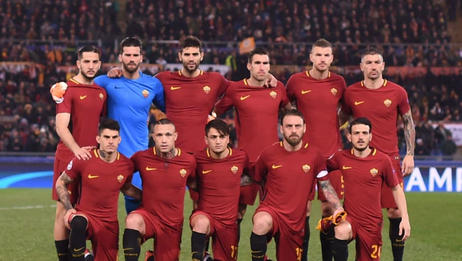 AS Roma's team players (from top left) Roma's Greek defender Kostas Manolas, Roma's Brazilian goalkeeper Alisson, Roma's Argentinian defender Federico Fazio, Roma's Dutch midfielder Kevin Strootman, Roma's Bosnian striker Edin Dzeko, Roma's Croatian defender Aleksandar Kolarov, Roma's Argentinian midfielder Diego Perotti, Roma's Belgian midfielder Radja Nainggolan, Roma's Turkish midfielder Cengiz Under, Roma's Italian midfielder Daniele De Rossi and Roma's Italian midfielder Alessandro Florenzi pose before the UEFA Champions League round of 16 second leg football match AS Roma vs Shakhtar Donetsk on March 13, 2018 at the Olympic stadium in Rome.  / AFP PHOTO / Filippo MONTEFORTE        (Photo credit should read FILIPPO MONTEFORTE/AFP/Getty Images)