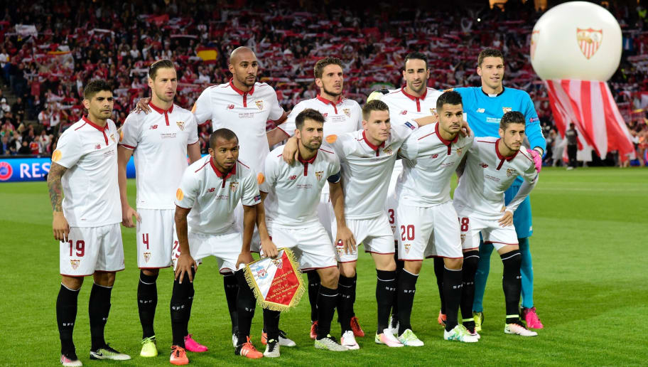 (First row L to R) Sevilla's Brazilian defender Mariano Ferreira, Sevilla's Spanish defender Coke, Sevilla's French forward Kevin Gameiro, Sevilla's midfielder Vitolo and Sevilla's Spanish defender Sergio Escudero (2nd row L to R) Sevilla's Argentinian midfielder Ever Banega, Sevilla's Polish midfielder Grzegorz Krychowiak, Sevilla's French midfielder Steven N'Zonzi, Sevilla's Portuguese midfielder Daniel Carrico, Sevilla's French defender Adil Rami and Sevilla's Spanish goalkeeper David Soria pose prior to the UEFA Europa League final football match between Liverpool FC and Sevilla FC at the St Jakob-Park stadium in Basel, on May 18, 2016.  AFP PHOTO / JAVIER SORIANO / AFP / JAVIER SORIANO        (Photo credit should read JAVIER SORIANO/AFP/Getty Images)