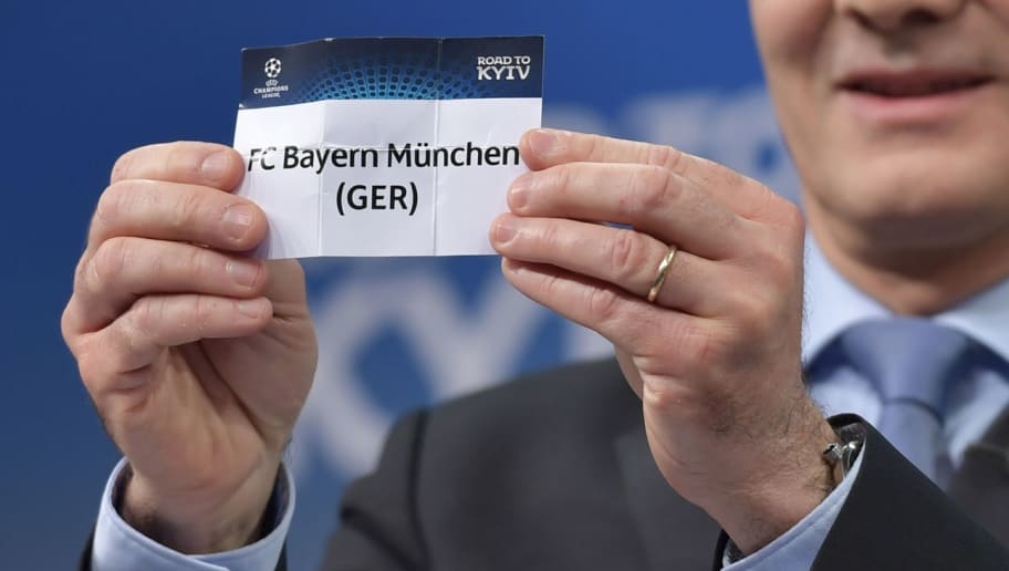 UEFA director of competitions Giorgio Marchetti shows the slip of Bayern Munich during the draw for the round of 16 of the UEFA Champions League football tournament at the UEFA headquarters in Nyon on December 11, 2017. / AFP PHOTO / Fabrice COFFRINI        (Photo credit should read FABRICE COFFRINI/AFP/Getty Images)