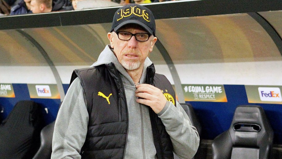 (L-R) Borussia Dortmund's head coach Peter Stöger react after the Europa League Round of 16 second leg football match between FC Salzburg and BV 09 Borussia Dortmund in Salzburg, Austria, on March 15, 2018.   / AFP PHOTO / APA / KRUGFOTO / Austria OUT        (Photo credit should read KRUGFOTO/AFP/Getty Images)