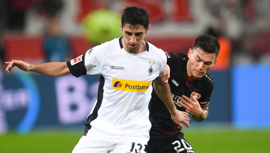 Moenchengladbach's German forward Lars Stindl (L) and Leverkusen's Chilean midfielder Charles Mariano Aranguiz vie for the ball during the German first division Bundesliga football match Bayer 04 Leverkusen vs Borussia Moenchengladbach, in Leverkusen, western Germany, on March 10, 2018. / AFP PHOTO / Patrik STOLLARZ / RESTRICTIONS: DURING MATCH TIME: DFL RULES TO LIMIT THE ONLINE USAGE TO 15 PICTURES PER MATCH AND FORBID IMAGE SEQUENCES TO SIMULATE VIDEO. == RESTRICTED TO EDITORIAL USE == FOR FURTHER QUERIES PLEASE CONTACT DFL DIRECTLY AT + 49 69 650050         (Photo credit should read PATRIK STOLLARZ/AFP/Getty Images)