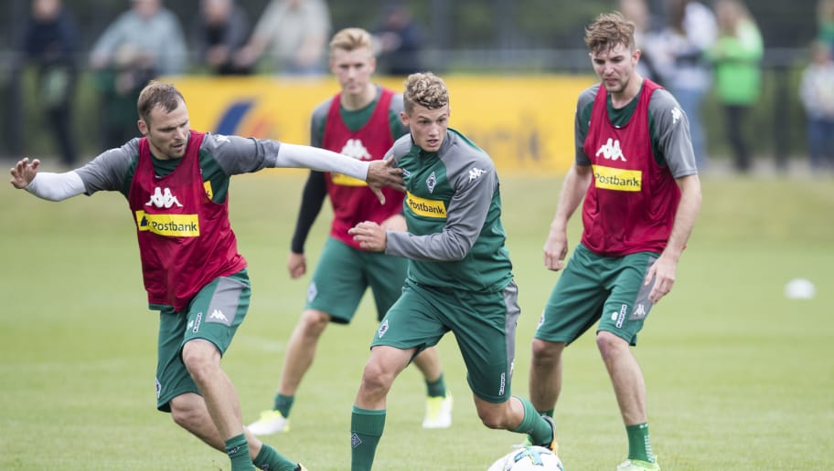 MOENCHENGLADBACH, GERMANY - JULY 02: Mickael Cuisance (C) and Tony Jantschke of Moenchengladbach  ballte for the ball during Training Session on July 2, 2017 in Moenchengladbach, Germany. (Photo by Maja Hitij/Bongarts/Getty Images )