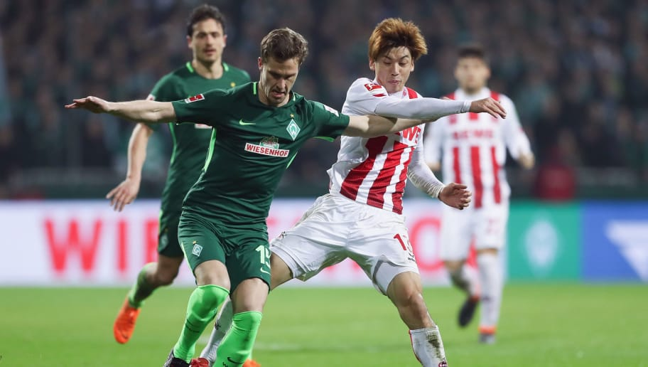 BREMEN, GERMANY - MARCH 12: Sebastian Langkamp (L) of Bremen is challenged by Yuya Osako of Koeln during the Bundesliga match between SV Werder Bremen and 1. FC Koeln at Weserstadion on March 12, 2018 in Bremen, Germany.  (Photo by Lars Baron/Bongarts/Getty Images)