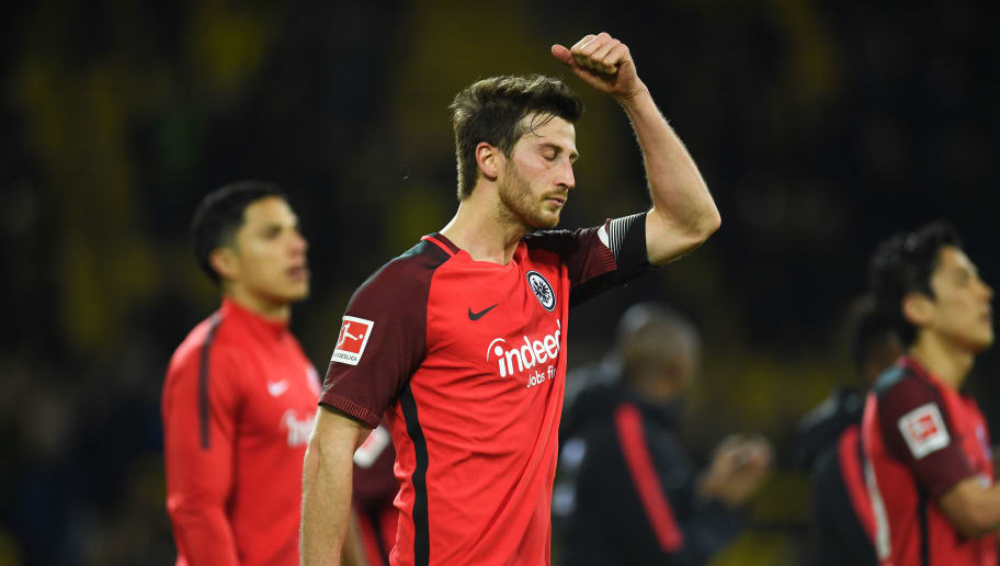 Frankfurt's Argentinian defender David Abraham reacts after the German first division Bundesliga football match Borussia Dortmund vs Eintracht Frankfurt, in Dortmund, western Germany, on March 11, 2018. / AFP PHOTO / Patrik STOLLARZ / RESTRICTIONS: DURING MATCH TIME: DFL RULES TO LIMIT THE ONLINE USAGE TO 15 PICTURES PER MATCH AND FORBID IMAGE SEQUENCES TO SIMULATE VIDEO. == RESTRICTED TO EDITORIAL USE == FOR FURTHER QUERIES PLEASE CONTACT DFL DIRECTLY AT + 49 69 650050         (Photo credit should read PATRIK STOLLARZ/AFP/Getty Images)