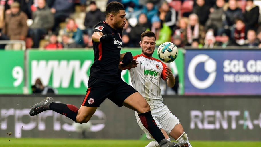 Frankfurt's French defender Simon Falette and Augsburg's German midfielder Marcel Heller vie for the ball during the German first division Bundesliga football match 1 FC Augsburg vs Eintracht Frankfurt in Augsburg, southern Germany, on February 4, 2018. / AFP PHOTO / Guenter SCHIFFMANN / RESTRICTIONS: DURING MATCH TIME: DFL RULES TO LIMIT THE ONLINE USAGE TO 15 PICTURES PER MATCH AND FORBID IMAGE SEQUENCES TO SIMULATE VIDEO. == RESTRICTED TO EDITORIAL USE == FOR FURTHER QUERIES PLEASE CONTACT DFL DIRECTLY AT + 49 69 650050         (Photo credit should read GUENTER SCHIFFMANN/AFP/Getty Images)