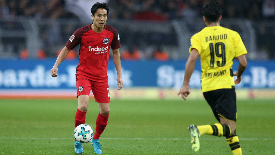 DORTMUND, GERMANY - MARCH 11:  Makoto Hasebe of Frankfurt controls the ball during the Bundesliga match between Borussia Dortmund and Eintracht Frankfurt at Signal Iduna Park on March 11, 2018 in Dortmund, Germany.  (Photo by Lars Baron/Bongarts/Getty Images)