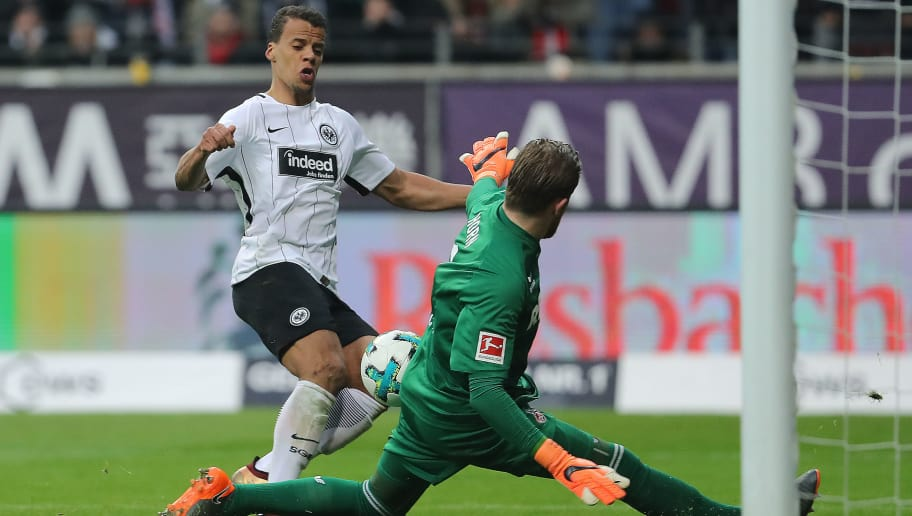 FRANKFURT AM MAIN, GERMANY - FEBRUARY 10: Timothy Chandler of Frankfurt (l) tries to play the ball past goalkeeper Timo Horn of Koeln during the Bundesliga match between Eintracht Frankfurt and 1. FC Koeln at Commerzbank-Arena on February 10, 2018 in Frankfurt am Main, Germany. (Photo by Simon Hofmann/Bongarts/Getty Images)