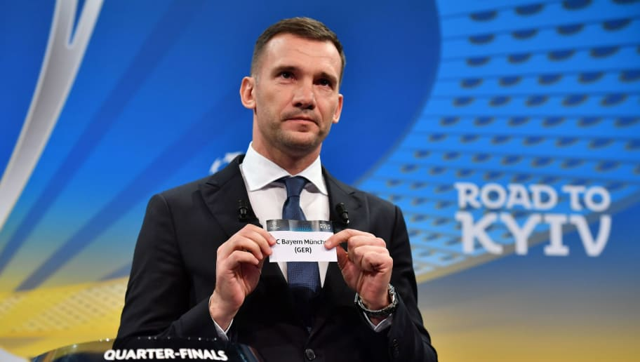 Former Ukrainian football player and ambassador for the UEFA Champion League final in Kiev Andriy Shevchenko shows the slip of FC Bayern Munchen during the draw for the quarter finals round of the UEFA Champions League football tournament at the UEFA headquarters in Nyon on March 16, 2018. / AFP PHOTO / Fabrice COFFRINI        (Photo credit should read FABRICE COFFRINI/AFP/Getty Images)