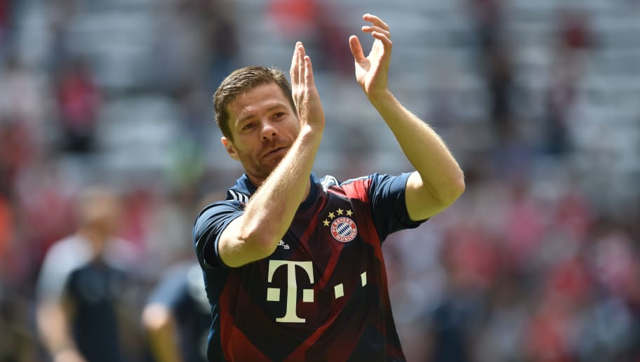 Bayern Munich's Spanish midfielder Xabi Alonso is pictured prior his last his last Bundesliga football match after the German first division Bundesliga football match FC Bayern Munich vs SC Freiburg in the stadium of Munich, southern Germany, on May 20, 2017. / AFP PHOTO / Christof STACHE        (Photo credit should read CHRISTOF STACHE/AFP/Getty Images)