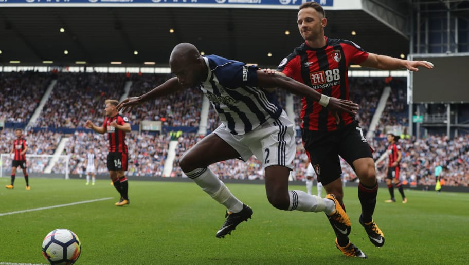 WEST BROMWICH, ENGLAND - AUGUST 12: Allan Nyom of West Bromwich Albion holds off Marc Pugh of AFC Bournemouth during the Premier League match between West Bromwich Albion and AFC Bournemouth at The Hawthorns on August 12, 2017 in West Bromwich, England.  (Photo by David Rogers/Getty Images)