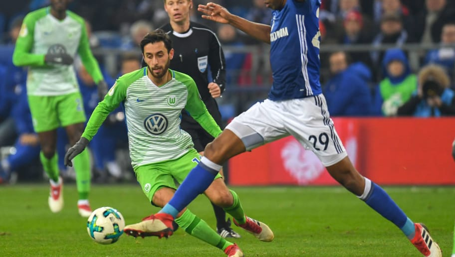 Wolfsburg's Turkish midfielder Yunus Malli and Schalke's Brazilian defender Naldo vie for the ball during the German football Cup DFB Pokal quarter-final match FC Schalke 04 versus VFL Wolfsburg on February 7, 2018 in Gelsenkirchen.  / AFP PHOTO / Patrik STOLLARZ / RESTRICTIONS: ACCORDING TO DFB RULES IMAGE SEQUENCES TO SIMULATE VIDEO IS NOT ALLOWED DURING MATCH TIME. MOBILE (MMS) USE IS NOT ALLOWED DURING AND FOR FURTHER TWO HOURS AFTER THE MATCH. == RESTRICTED TO EDITORIAL USE == FOR MORE INFORMATION CONTACT DFB DIRECTLY AT +49 69 67880   /         (Photo credit should read PATRIK STOLLARZ/AFP/Getty Images)