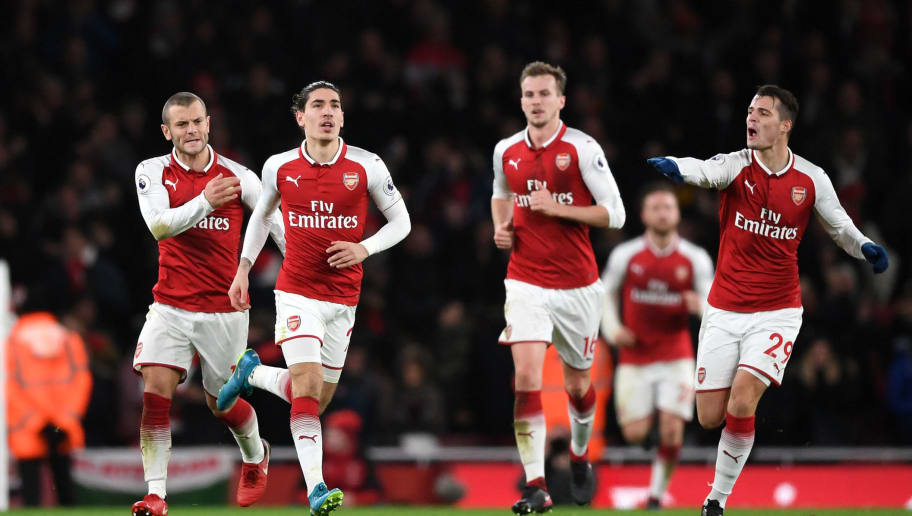 LONDON, ENGLAND - JANUARY 03:  Hector Bellerin of Arsenal celebrates with Jack Wilshere, Rob Holding and Granit Xhaka after he scores his sides second goal during the Premier League match between Arsenal and Chelsea at Emirates Stadium on January 3, 2018 in London, England.  (Photo by Shaun Botterill/Getty Images)